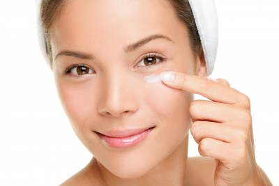 woman applying anti wrinkle cream